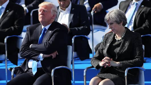 President, Donald Trump and British Prime Minister, Theresa May are pictured ahead of a photo opportunity of leaders as they arrive for a NATO summit meeting on May 25, 2017 in Brussels, Belgium.