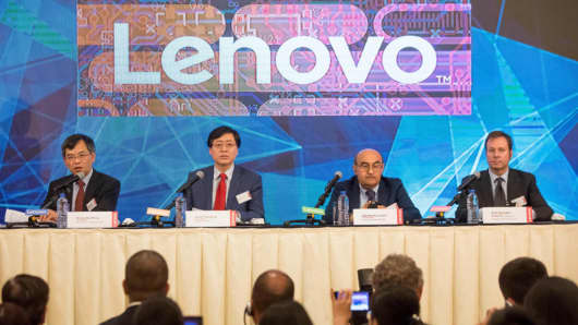 Wong Wai Ming, chief financial officer, of Lenovo, Yang Yuanqing, chairman and chief executive officer, Gianfranco Lanci, president and chief operating officer, and Kirk Skaugen, executive vice president of data center group, attend a news conference in Hong Kong, China, on Thursday, May 25, 2017.