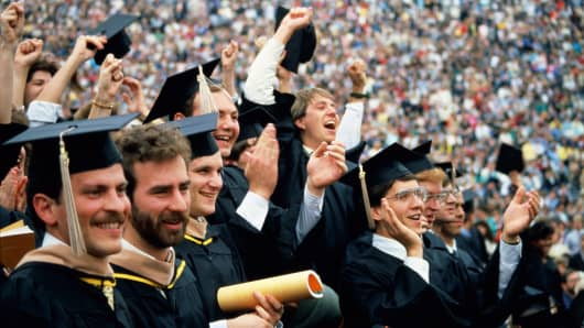 College students graduating.