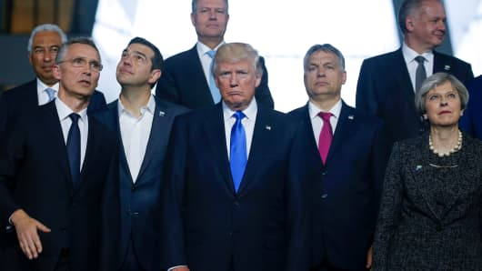 U.S. President Donald Trump poses with fellow world leaders during a NATO summit in Brussels, Belgium, May 25, 2017.