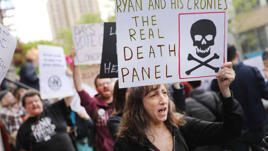 Dozens of health care activists protest in front of a Harlem charter school before the expected visit of House Speaker Paul Ryan on May 9, 2017 in New York City.