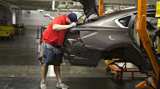 A worker assembles a Nissan Altima mid-size vehicle at the company's North America manufacturing plant in Canton, Mississippi.