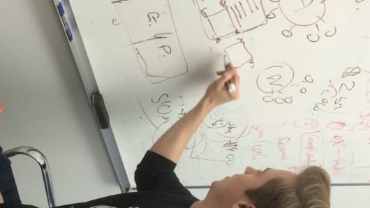 Pete Johnston scribbles on a whiteboard at Kalo's headquarters