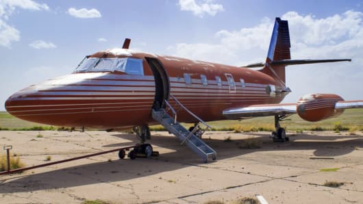 This undated file photo provided by GWS Auctions, Inc. shows a private jet once owned by Elvis Presley, on a runway in New Mexico. The plane has been auctioned after sitting on a runway in New Mexico for 35 years. The plane sold for $430,000 on Saturday, May 27, 2017, at an Agoura Hills, Calif., event featuring celebrity memorabilia, GWS Auctions Inc. said.