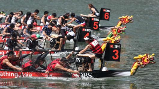 Dragon boats race during the DBS Marina Regatta in Singapore.