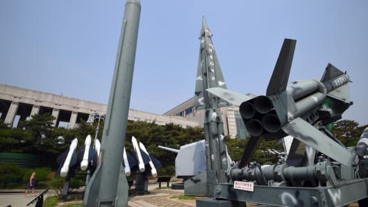 Replicas of a North Korean Scud-B missile (L) and South Korean Nike missiles (R) displayed at the Korean War Memorial in Seoul on May 29, 2017.