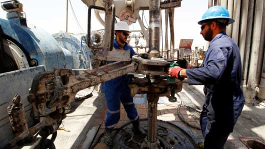 Men work for Iraqi Drilling Company at Rumaila oilfield in Basra, Iraq,