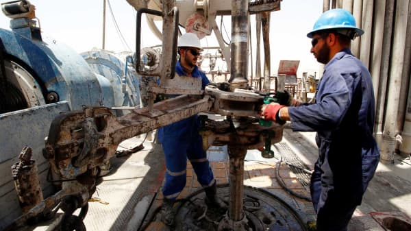 Men work for Iraqi Drilling Company at Rumaila oilfield in Basra, Iraq,