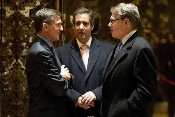 Michael Flynn, Michael Cohen and Rick Perry talk with each other in the lobby at Trump Tower, December 12, 2016 in New York City.