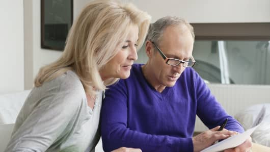 A popular theory has it retirees will depress market returns by pulling their savings out of 401(k) plans so they can spend more.