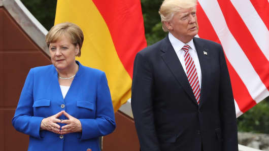 German Chancellor Angela Merkel, U.S. President Donald Trump arrive for the group photo at the G7 Taormina summit on the island of Sicily on May 26, 2017 in Taormina, Italy.