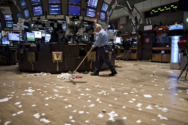 Jose Motolinia cleans up after the close of trading on the floor of the New York Stock Exchange.