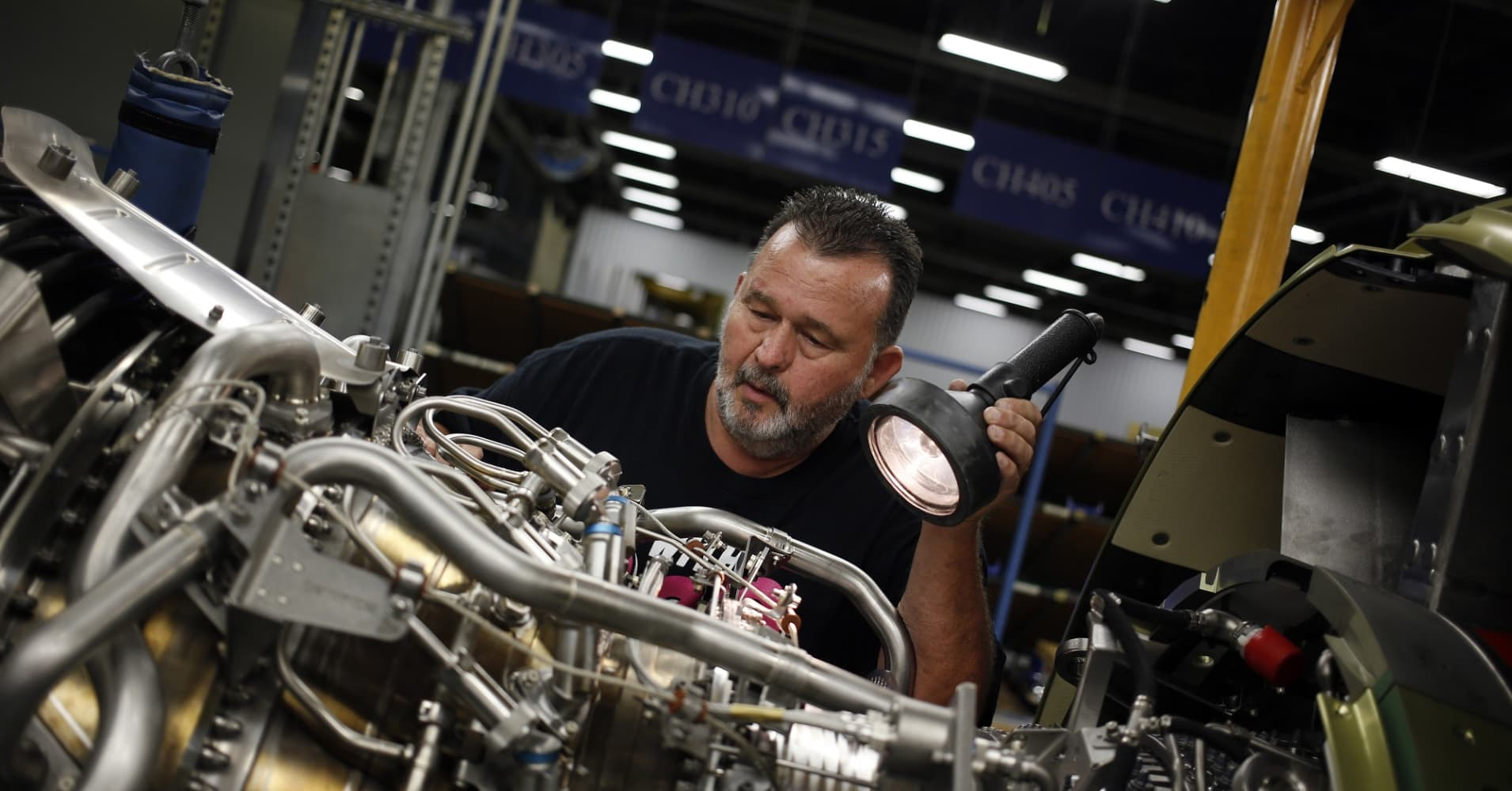A production assembly mechanic performs a final inspection on a CFM56-7 jet engine.