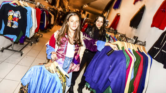 Samantha, left, and Morgan Elias, twin sisters who founded Vintage Twin, a pop-up secondhand clothing company, at one of their pop-up stores in New York, May 25, 2017.