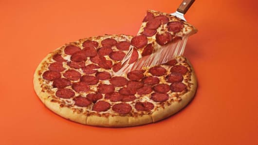 "Little Caesars' new ""ExtraMostBest"" Pizza is a regularly sized pie with mozzarella, muenster cheese and more than 50 slices of pepperoni, for $6.'"