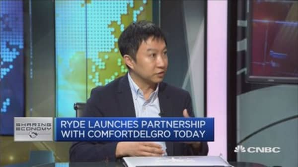 Ride-sharing firm Ryde partners with Singapore's largest taxi company to take on Uber, Grab