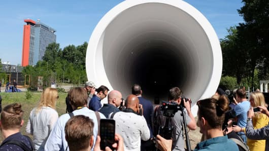 People look at a hyperloop test facility unveiled by a tech startup and a construction company in Delft, Netherlands, Thursday, June 1, 2017.
