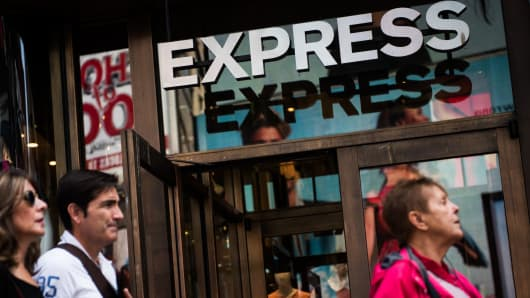 Pedestrians walk past an Express Inc. store in New York, U.S., on Wednesday, May 31, 2017.