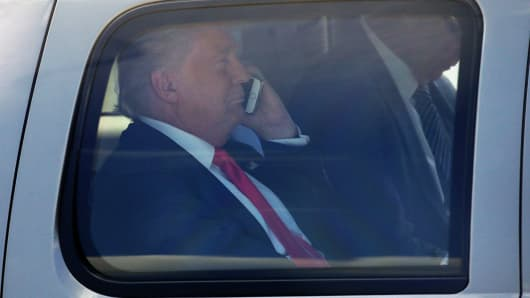 Donald Trump talks on his phone.