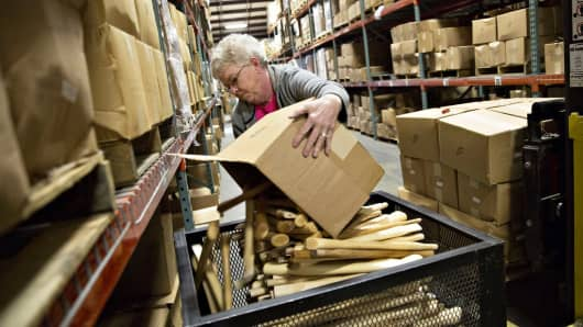 An employee sorts a box of wood handles in the warehouse of the Vaughan & Bushnell Manufacturing Co. facility in Bushnell, Illinois.