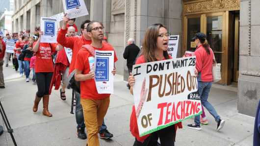 Chicago Teachers Union employees and supporters protest outside of City Hall in Chicago, on July 2, 2015.