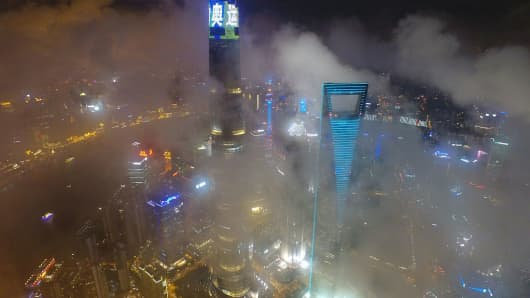 "An aerial view of Shanghai Tower, lit with the words ""Olympic Games"" in Chinese, on August 6, 2016 in Shanghai, China."
