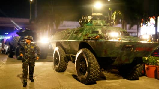 Armored Personnel Carriers of the Philippine National Police arrive at the Resorts World Manila complex early Friday, June 2, 2017 in suburban Pasay city southeast of Manila, Philippines.
