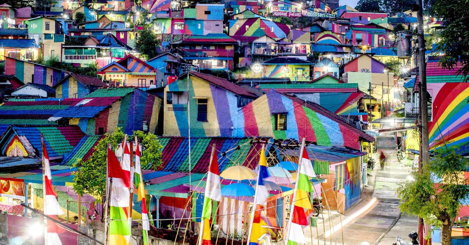 residents transform slum to rainbow village tourist mecca