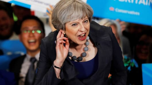 Britain's Prime Minister Theresa May reacts as she speaks at an election campaign event at Pride Park Stadium on June 1, 2017 in Derby, United Kingdom.