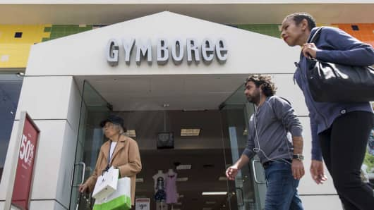 Pedestrians walk past a Gymboree store in San Francisco, California.