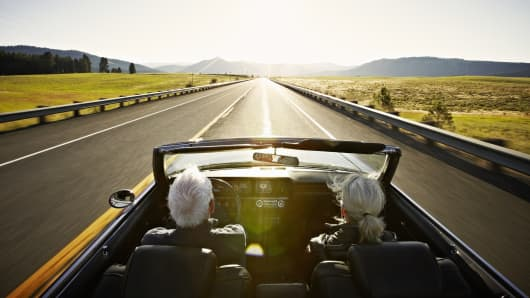 Senior couple driving and thinking about their Social Security strategy