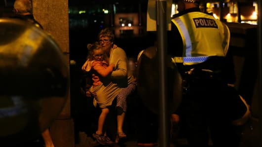 People flee as police attend to an incident near London Bridge in London, Britain, June 4, 2017.