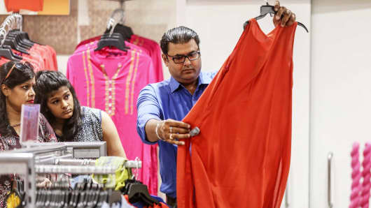 Customers look at a dress at a Big Bazaar hypermarket, operated by Future Retail Ltd., in Mumbai, India, April 16, 2017.