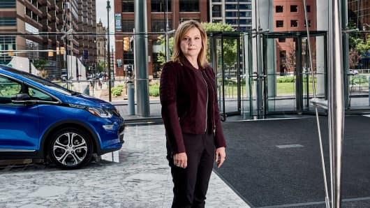 Mary Barra, the chief executive of General Motors, with a self-driving Chevrolet Bolt EV at GM headquarters in Detroit, June 2, 2017.