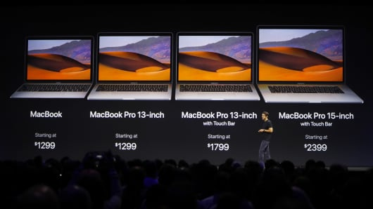 John Ternus, Vice President, Mac and iPad Hardware Engineering speaks under a graphic of price points for the Macbook laptop family during Apple's annual world wide developer conference (WWDC) in San Jose, California, U.S. June 5, 2017.
