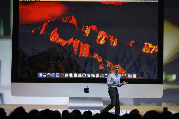 Craig Federighi, Senior Vice President Software Engineering speaks under a projection image of an iMac computer during the company's annual world wide developer conference (WWDC) in San Jose, California, U.S. June 5, 2017.