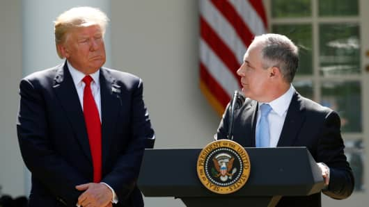 President Donald Trump (L) listens to EPA Administrator Scott Pruitt after announcing his decision that the United States will withdraw from the Paris Climate Agreement, in the Rose Garden of the White House in Washington, U.S., June 1, 2017.