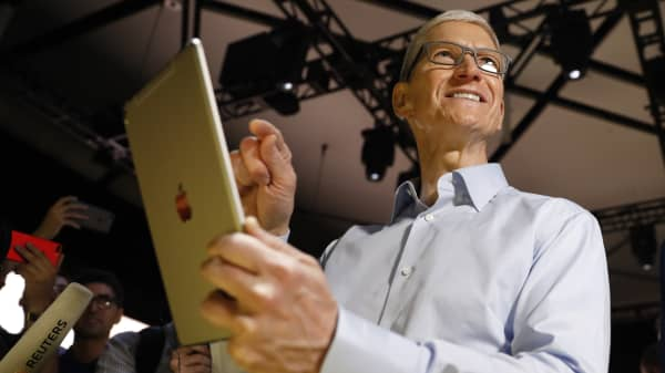 Tim Cook, CEO, holds an iPad Pro after his keynote address to Apple's annual world wide developer conference (WWDC) in San Jose, California, U.S. June 5, 2017.