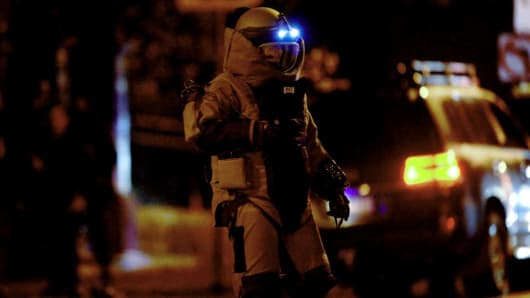 A bomb squad member exits a residential building in the Melbourne bayside suburb of Brighton on June 5, 2017, after a woman was held against her will in an apartment block in an incident authorities had yet to determine whether was terrorism-related. Australian police on June 5 shot dead a man who took the woman hostage in a Melbourne apartment, after the body of another man w