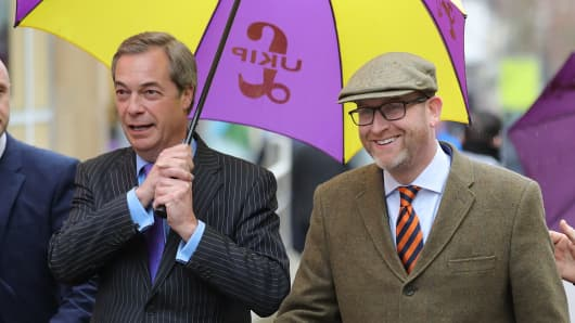 UKIP leader Paul Nuttall (R) and former leader Nigel Farage MEP arrive in Stoke-On-Trent for a public meeting on February 6, 2017 in Stoke, England.