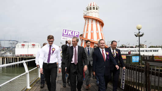 Former UKIP leader Nigel Farage walks along Clacton Pier with Aaron Hammond (L), UKIP candidate for Harwich and Paul Oakley (R), candidate for Clacton on June 2, 2017 in Clacton-on-Sea, England.