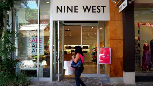 A shopper walks past a Nine West Group store at the La Cantera outdoor mall in San Antonio, Texas.