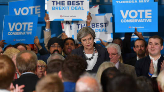 Britain's Prime Minister Theresa May addresses supporters at a campaign event in Slough in south-east England on June 6, 2017.