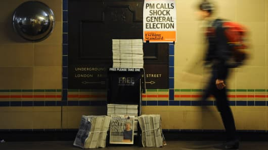A newspaper stand shows a copy of today's Evening Standard, with the front page story relating to British Prime Minister Theresa May's call for a snap general election on June 8, in central London on April 18, 2017.