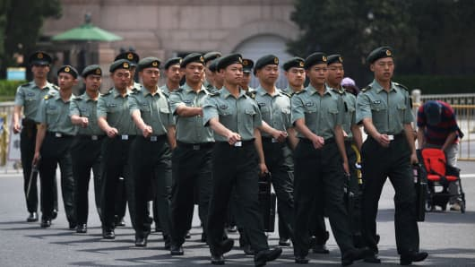 Chinese soldiers march to their barracks from Tiananmen Square