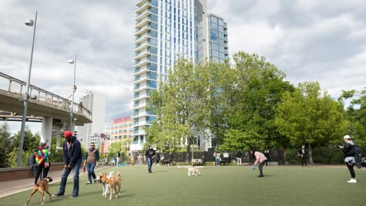 One Riverside, the first newly constructed condo tower in central Philadelphia in seven years, is seen from the Schuylkill River Park dog park, May 8, 2017.