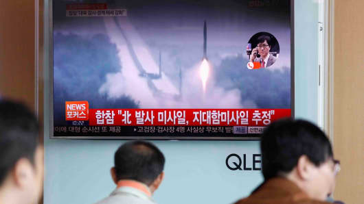 People watch a television news report on North Korea firing what appears to be several land-to-ship missiles off its east coast at a railway station in Seoul, South Korea, on June 8, 2017.