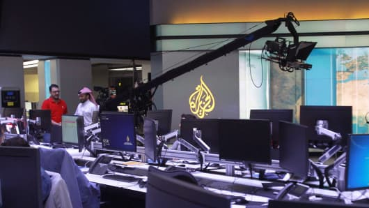 Staff work inside the headquarters of Al Jazeera Media Network, in Doha, Qatar June 8, 2017.