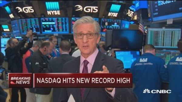 Markets open higher as Nasdaq hits new record high