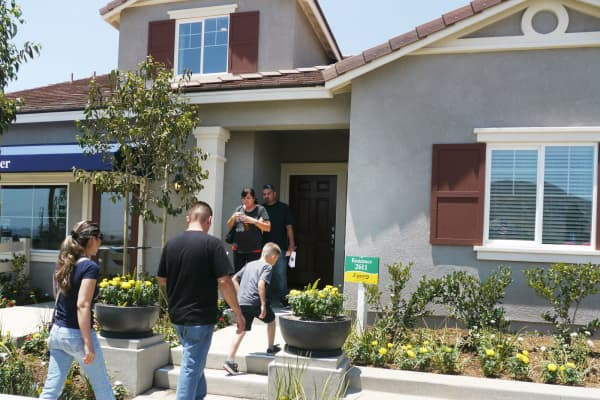 Prospective home owners tour a home in Jurupa Valley, California.